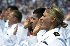 U.S. Navy ensign takes the oath of office at t...
