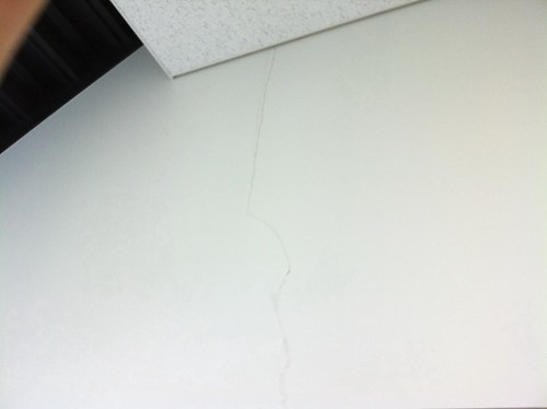 Cracks on the walls in the building of my company, built by Shimizu Corporation