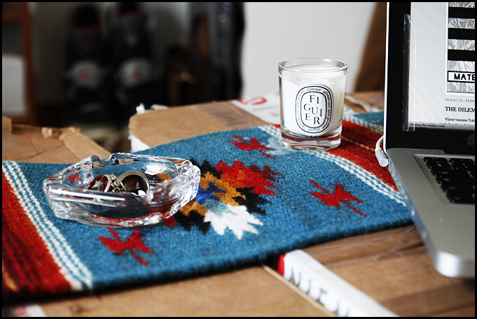 2011_02 Essentials at my Home in Dublin - My Cardboard Box Coffe Table with Macbook, Native American Table Rug, Some Jewelery in Supreme Ashtray and my Favorite Scented Candle by Diptyque