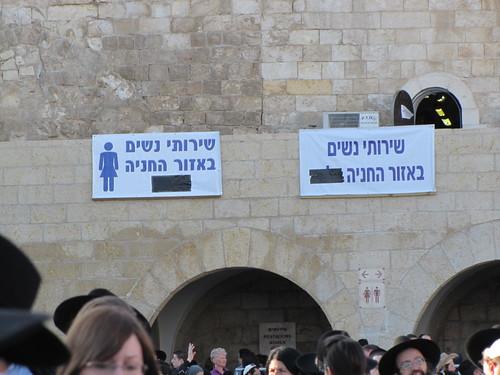 Sign: women's restroom in rear