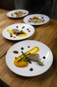 Smoked Sturgeon with black garlic dashi, pickled Glorious Organics vegetables from The Observatory