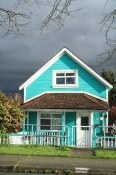 House in Strathcona and approaching storm