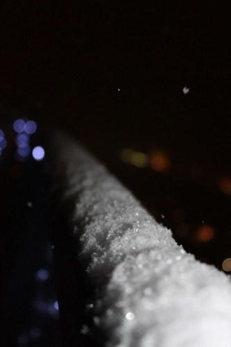 Long snowy railing