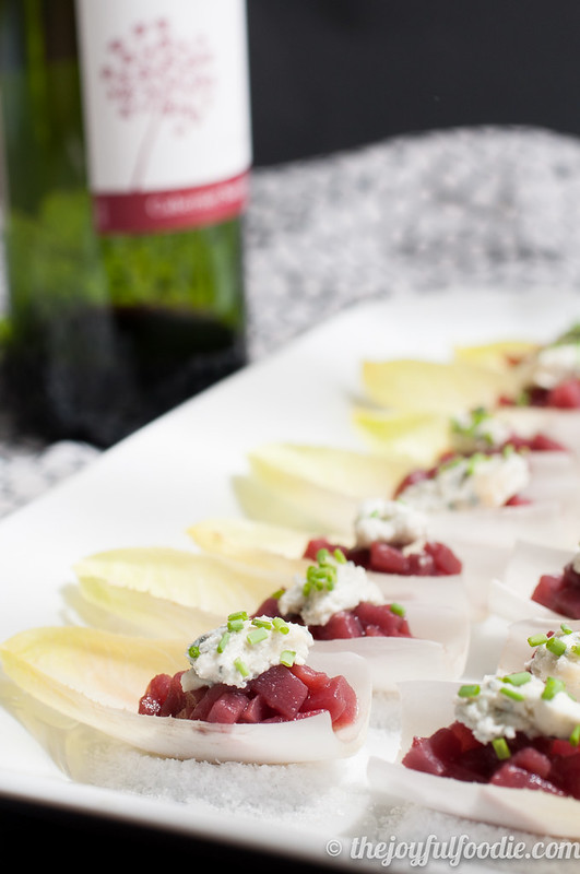 Spiced pears with tangy, herbed goat cheese served over crisp endive - an easy and impressive appetizer or hors d'oeuvre.