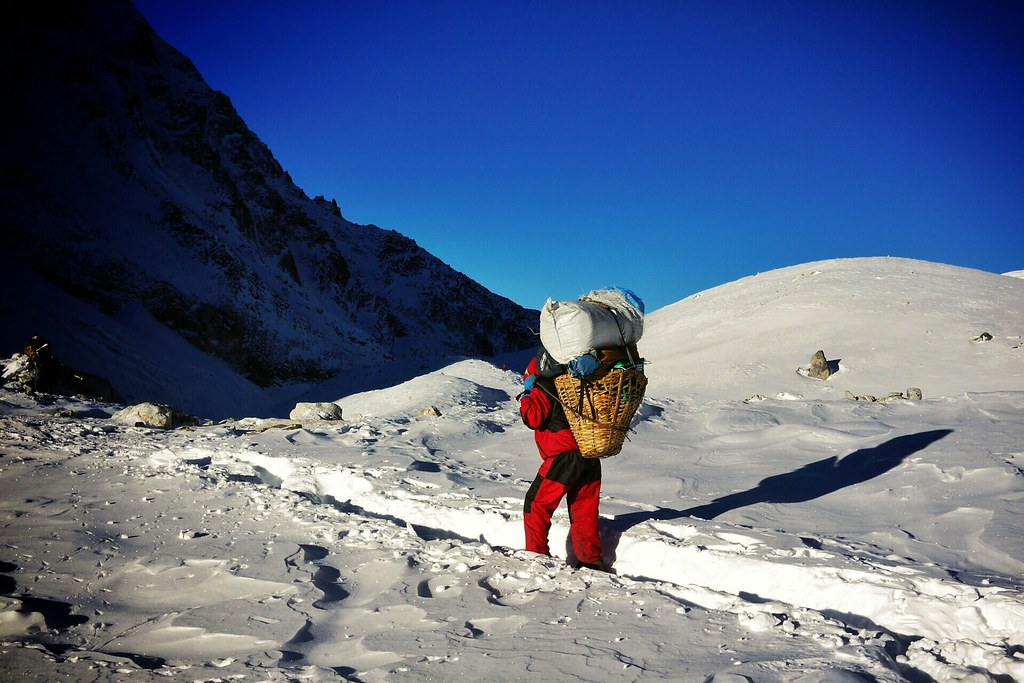 Porter on Larkya Pass