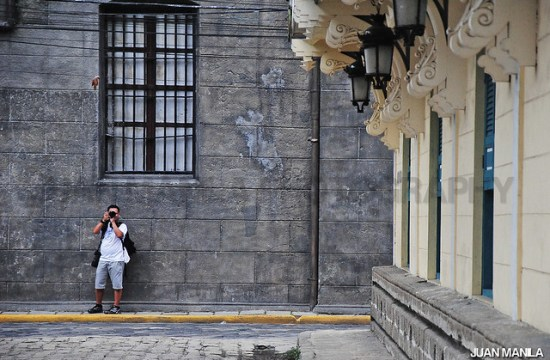 Photographer capturing the inner beauty of lines and patterns behind the walls of Intramuros.