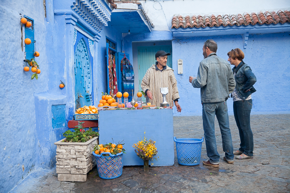 Fresh orange juice vendor at Chefchaouen Medina, Morocco