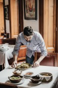 Marcelo admires one of the most memorable dishes from our trip at El Cardenal…