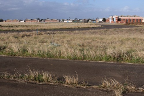Looking over the abandoned RAAF Williams airfield towards the hangars