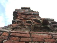 Paull Holme Tower looking up at crennelations