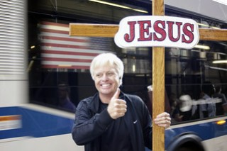A Smily Guy Cheering for Jesus