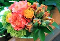 'Free Spirit' roses, yellow ranunculus and 'Prinses Irene' parrot tulips