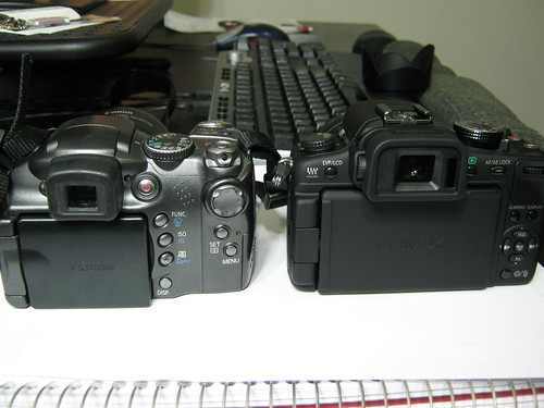 canon powershot s3 is vs panasonic lumix dmc-g2 - from the rear