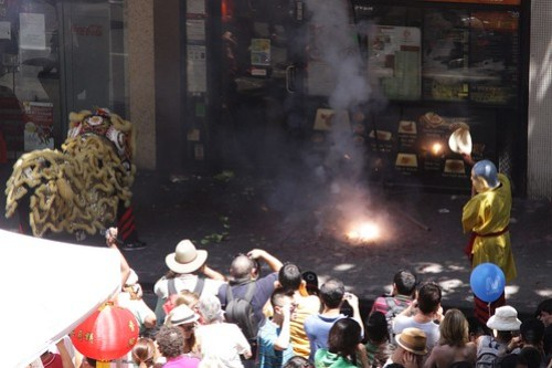 Setting off firecrackers outside a Melbourne restaurant for Chinese New Year