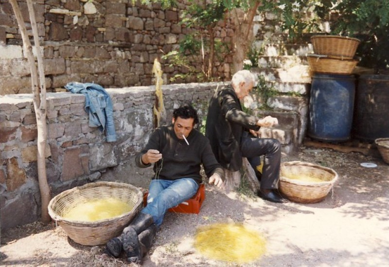 Men at work in Plomari on the island of Lesbos, Greece