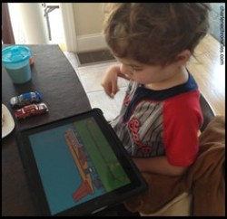 Boy playing with iPad