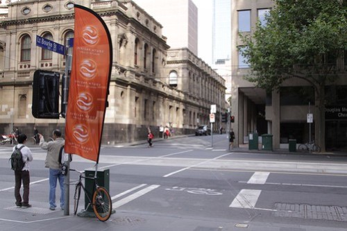 Advertising banner attached to a chained up bike