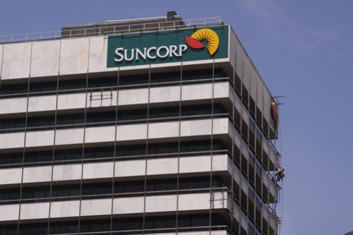 Upper levels of the Suncorp building, repains being carried out to the marble facade panels