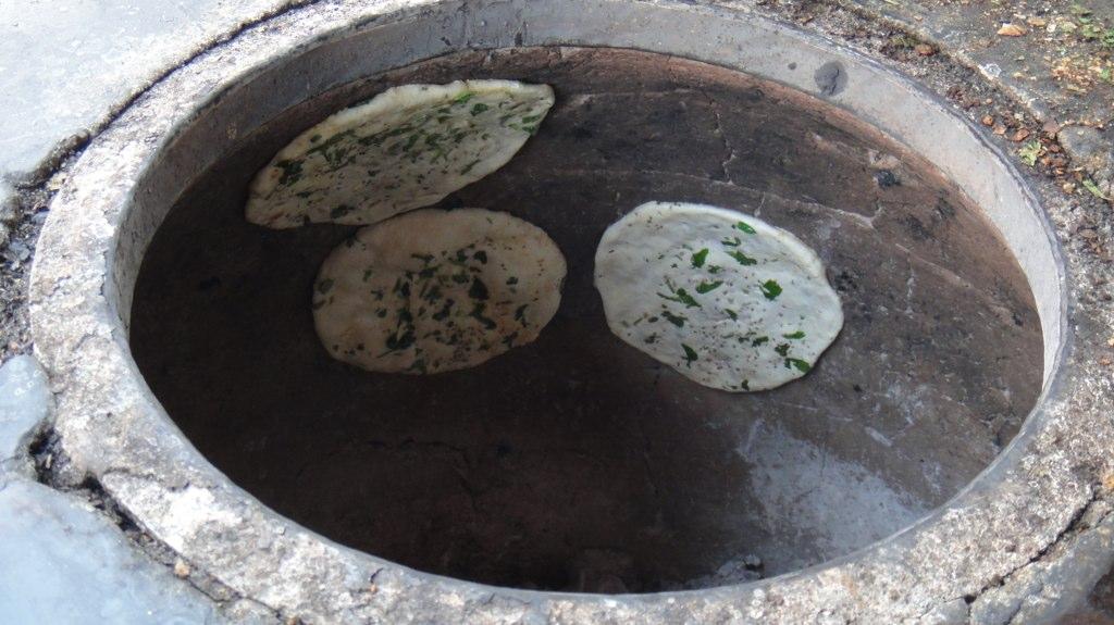 Naan roasting in the tandoor