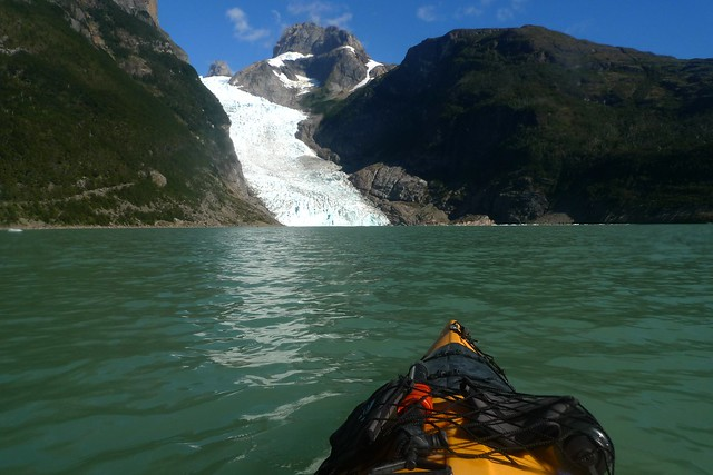 Sea kayak approaching glacier on lake
