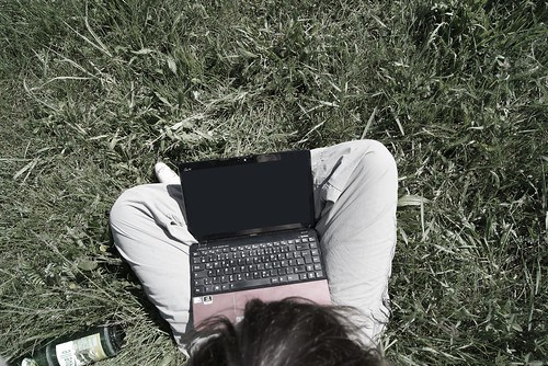 Sitting on the grass with laptop