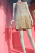 Gold dress clad mannequin in South Granville shop window