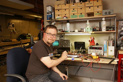 Self-portrait with soldering iron and oscilloscope