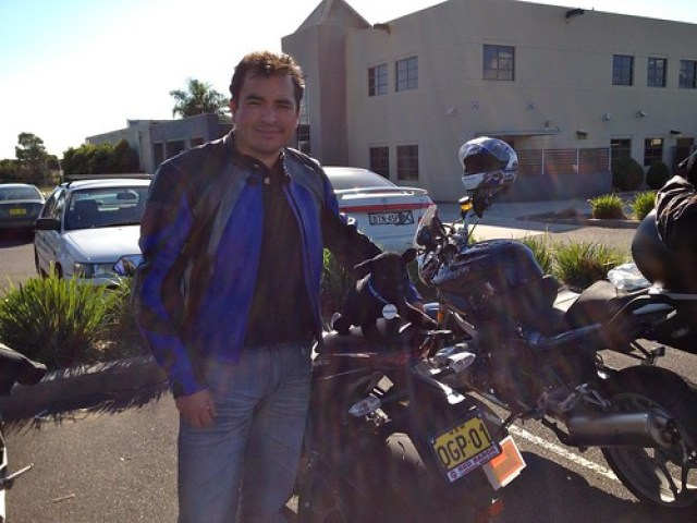 Ray Mera proudly sporting his Winston on his Ninja in Bateau Bay