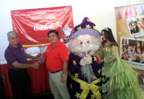Ceremonial Handshake betweeon Coca-Cola & Enchanted Kingdom