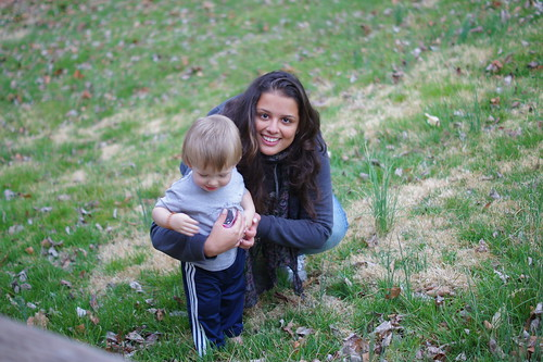 Our au pair having fun with our son in the back yard.