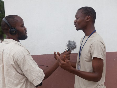 Participant Clarence Nah interviews a Cestos High School Student. By Ken Harper
