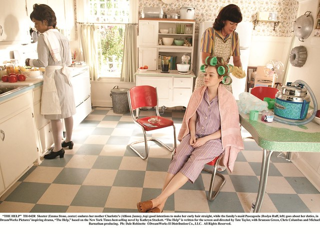 """THE HELP""..TH-042R..Skeeter (Emma Stone, center) endures her mother CharlotteÕs (Allison Janney, top) good intentions to make her curly hair straight, while the familyÕs maid Pascagoula (Roslyn Ruff, left) goes about her duties, in DreamWorks PicturesÕ i"