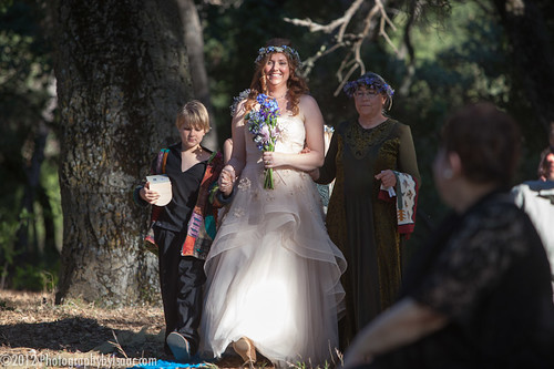 My son Caspian and my mom walk me down the aisle.