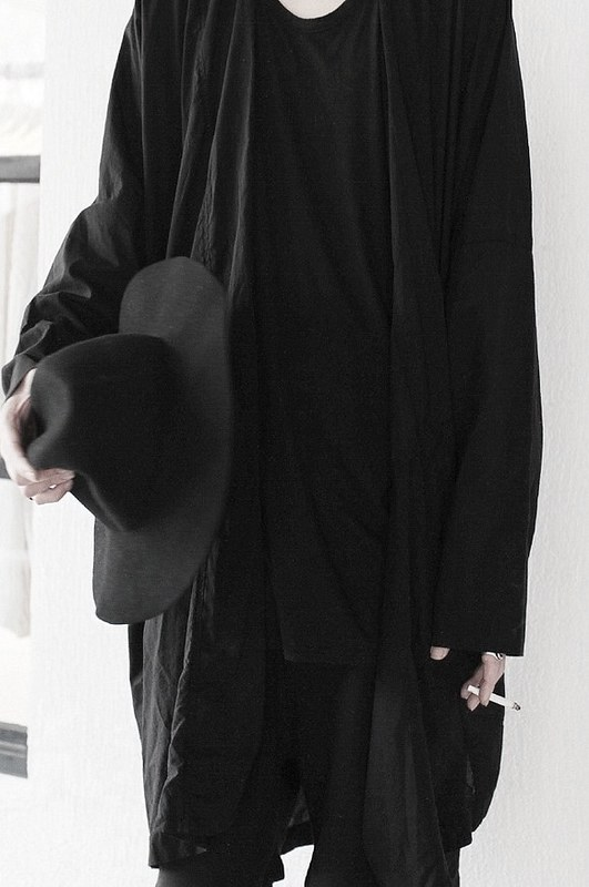 Unknown - Black Coat and Wide-Brim Hat.