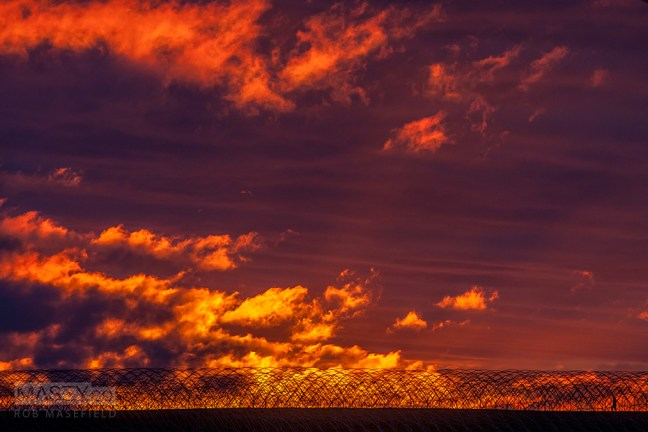 A spectacular Devonport sunrise over a farm in the distance.