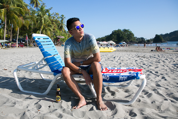 Bryanboy under the sun drinking a bottle of Imperial beer in Manual Antonio
