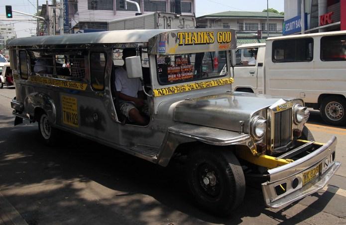 Thanks God sign on a jeepney