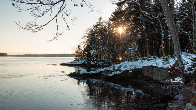 Sun Setting Over Sheepscot River Banks Covered in Snow