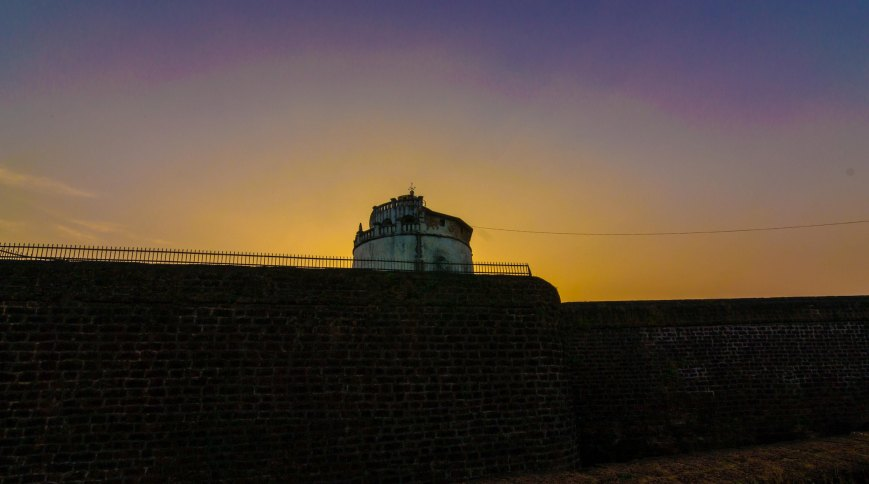 sunset at fort aguada goa photos