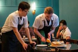 Zach serves Chef Curtis a slice