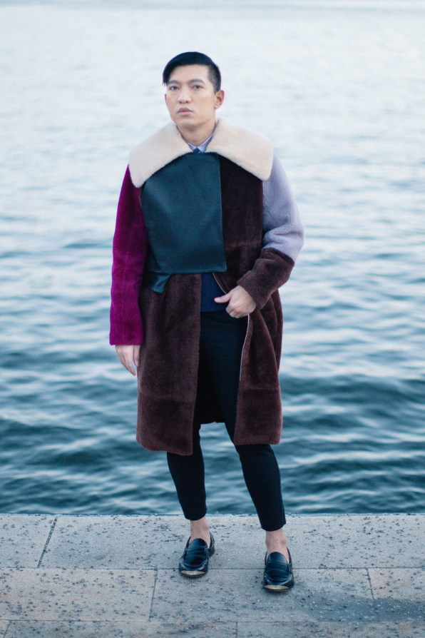 Fashion blogger Bryanboy wears a fall winter 2014 shearling coat by 3.1 Phillip Lim in Stockholm