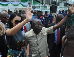 """Governor Adams Oshiomhole of Edo State and his wife, Iara, at the Ogbemudia Stadium to celebrate Nigeria's 56th Independence Anniversary, Saturday. • <a style=""""font-size:0.8em;"""" href=""""http://www.flickr.com/photos/139025336@N06/29831220180/"""" target=""""_blank"""">View on Flickr</a>"""