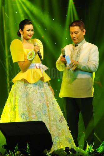 Tanya Montalbo Lodhi wore a yellow gown, steps up for the Q&A.