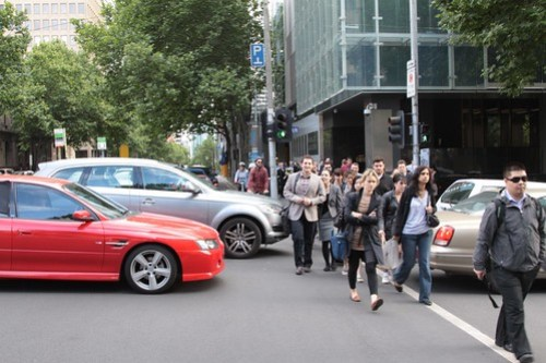 Cars block pedestrians at the corner of William and Lonsdale Streets