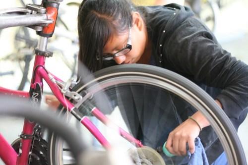 Teen practices bike maintenance at Santa Cruz Bike church