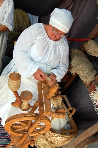 Woman spinning yarn