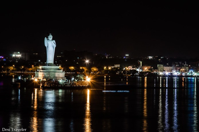 18 meter tall buddha statue in hussain Sagar illuminated in evening