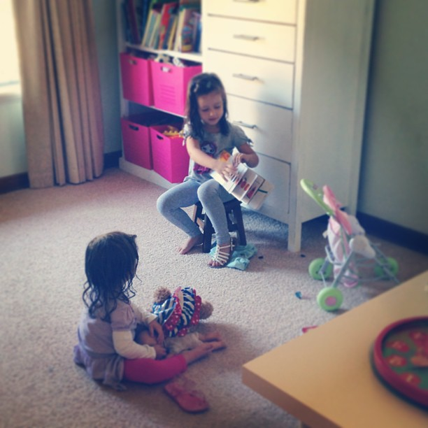 Story time at school... Love when these two play sweetly together! #latergram #sisters #mygirls