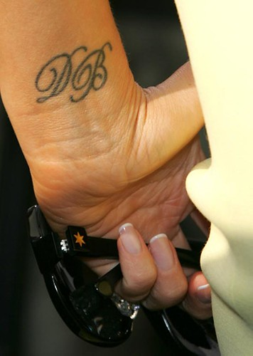 victoria beckham's left hand tattoo