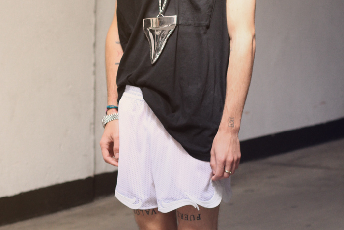 Alexander Wang top, Stella McCartney shorts, Givenchy necklace and septum, Dr Marten boots 3